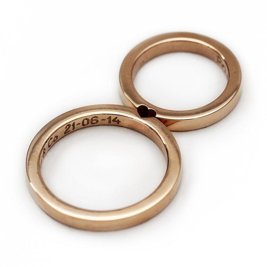 stock image white gold wedding rings bible image gold wedding bands White gold wedding rings on bible