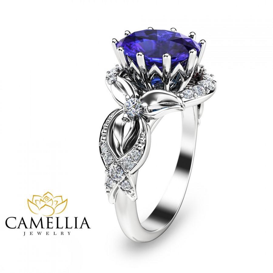 tanzanite diamond ring 14k rose gold tanzanite wedding rings Tanzanite and Diamond Elegant Ring in 14k Rose Gold 5 5mm