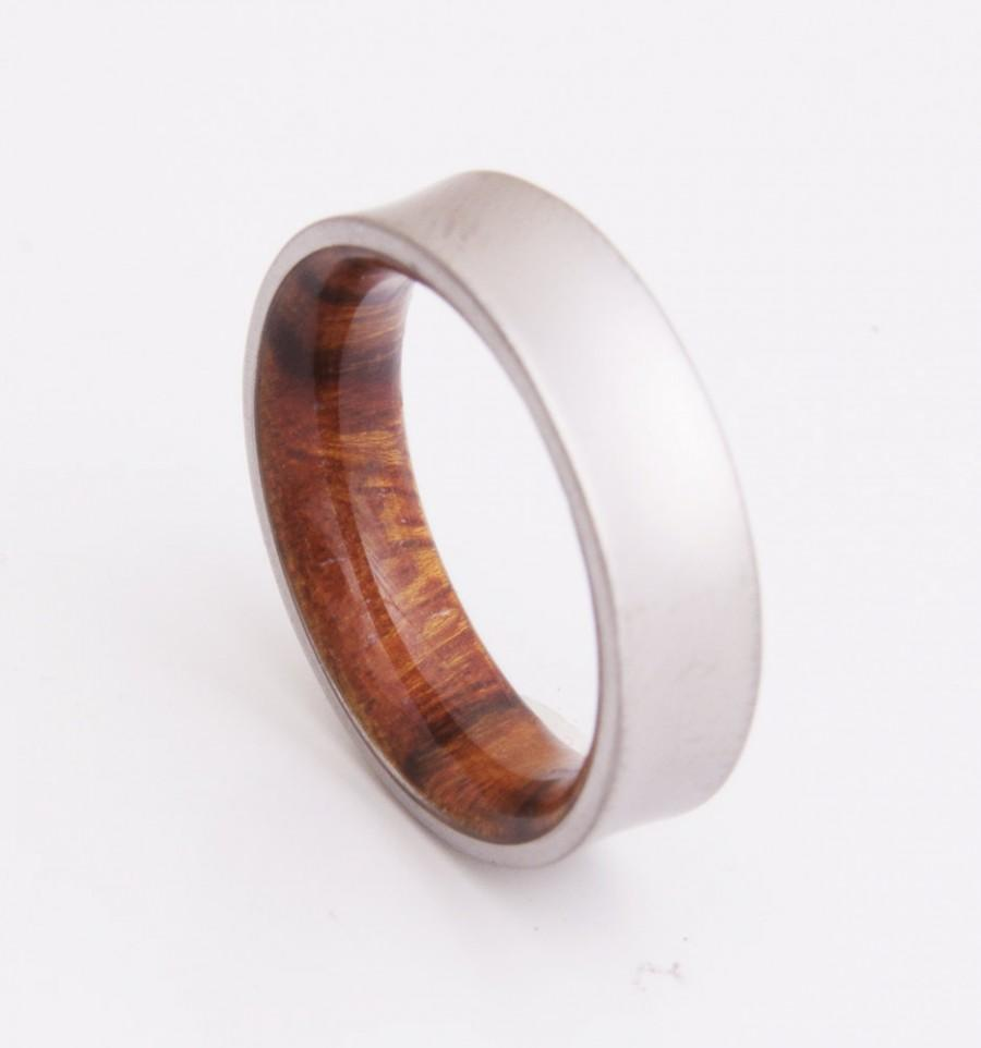 birch mahogany wooden wedding ring pair wood wedding rings A pair of wooden wedding rings made from mahogany and lined with birch wood