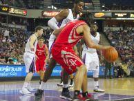 Kings forward/center Jason Thompson (left-center) guards Rockets forward-center Luis Scola in the post.