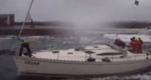 Insane Docking while Sailboat pounded by Gigantic Waves. VIDEO