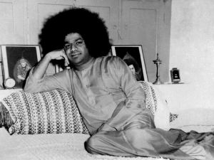 Photo of Sathya Sai Baba reclining on a divan