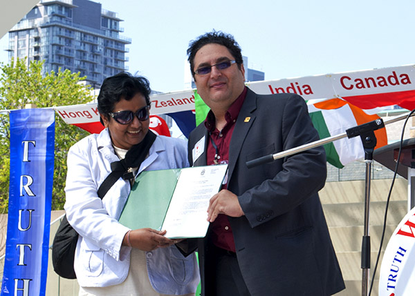 Sathya Sai School principal receives a certificate from Canadian MP