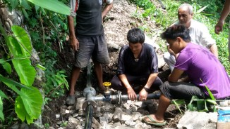 Skilled mechanics working on the water project