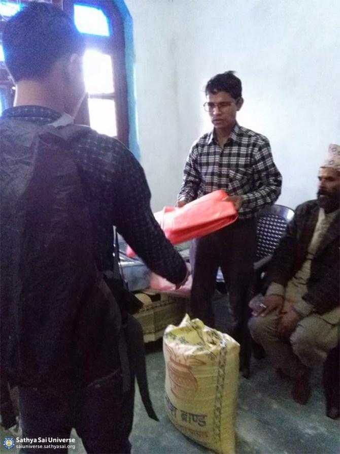distributing-reief-materials-at-mugu