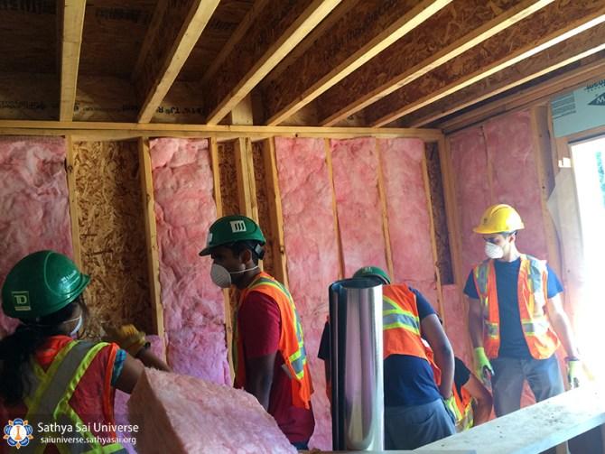 sai-youth-laying-insulation-1-copy