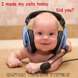 baby with blue eyes using a headset