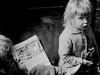 Salford child reading comic - Nick Hedges