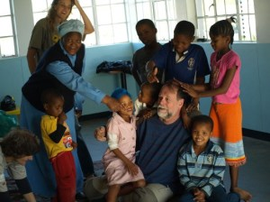 Fred Donaldson, an international expert for 'natural play', gave his first workshop in Namibia. During his stay, he spent an intensive hour on his floor mats with kids from the Moria Grace Shelter in Katatura, Windhoek. Mama Wilhelmina – the 'mother' of all kids was just as excited as the little ones who were all over Fred, riding, rolling and pulling his beard. Natural play is all about individual and flowing instinct to play, which has nothing to do with values, never damages and is without competition or fight. The movement of play and gentle touch are healing for the soul and creates a strong connection between all players. Around 40 teachers, therapists and parents joined the workshop on the 4/5th of September in the 'House of Science' and experienced how conflicts can be managed in a very simple, nonverbal and effective way. Foto: Katharina Wyss