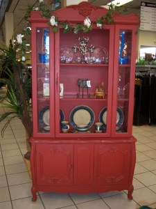 Photo of a red china cabinet.