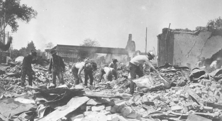 Search of rubble outside the Press Democrat building (California Historical Society)