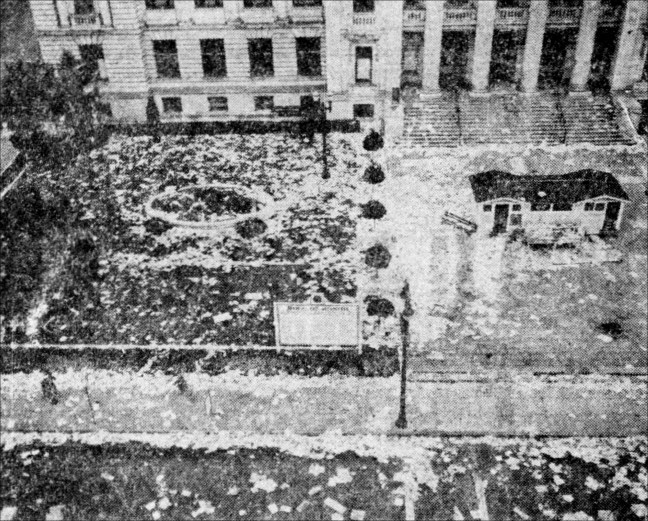 "Front of the Sonoma County courthouse covered in confetti and waste paper on Aug. 15, 1945. The little building in front of the steps was the ""Victory House"" built in 1944 to sell war bonds and stamps. Photo by U.S. Naval Air Station/Santa Rosa"