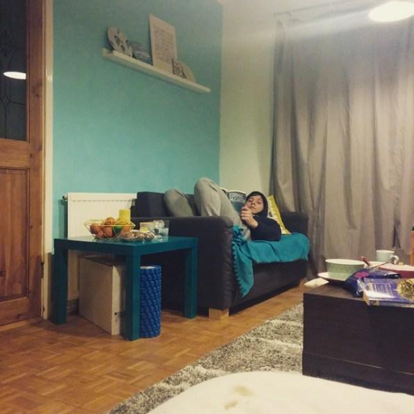 Reading on separate sofas, getting sleepy