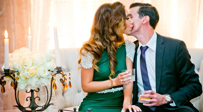 Couple Kissing with Champagne at Engagement Party