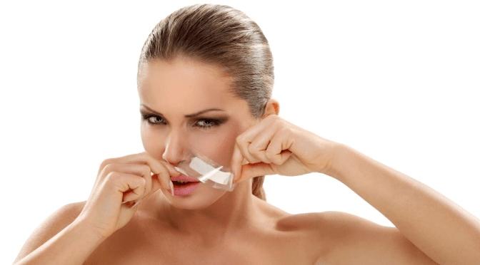 facial waxing trends woman waxing lip
