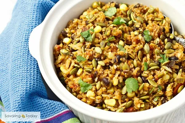 Cauliflower subs for the majority of rice in this low-carb, healthy pilaf recipe with flavors of the Southwest.