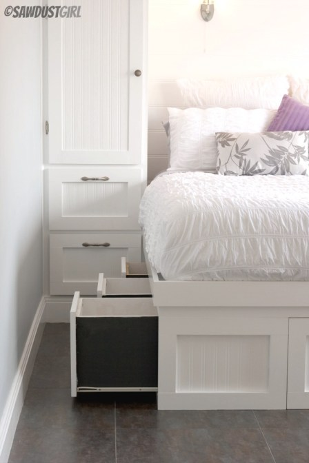 Small bedroom storage solution:  Built-in storage bed and built-in wardrobes.  http://sawdustgirl.com