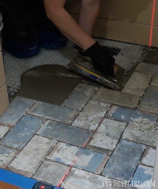 How to install herringbone brick tile flush with hardwood floor