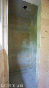 Installing waterproof panel shower walls.