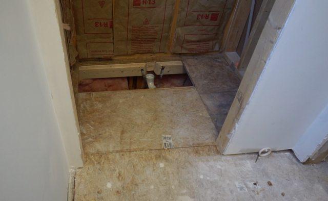 Installing preformed shower pan.