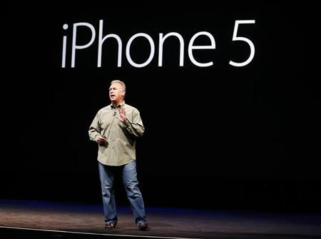 Phil Schiller, senior vice president of worldwide marketing at Apple Inc., introduces the iPhone 5 during Apple Inc.'s iPhone media event in San Francisco (Credit: Reuters/Beck Diefenbach)