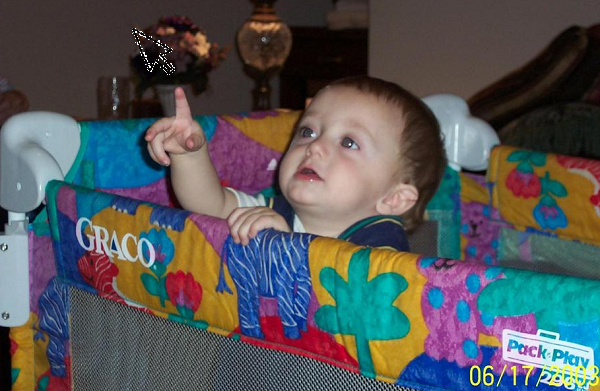 Baby pointing towards the cursor in the site