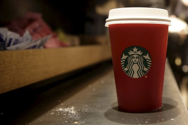 A red Starbucks cup sits on the counter of a Starbucks in New York November 10, 2015. REUTERS/Brendan McDermid
