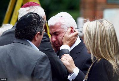 """Goodnight my angel, sleep tight."" Family and friends say a final farewell to Amy Winehouse."