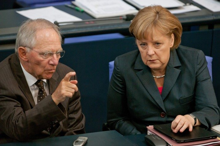 epa03264122 German Chancellor Angela Merkel (R) talks to German Finance Minister Wolfgang Schaeuble (L), after her state of the nation address before the upcoming G20 summit conference in Mexico, at the Bundestag in Berlin, Germany, 14 June 2012. Merkel defended her much criticised course in the Euro crisis and warned against excess of Germany's demands with new financial ties. EPA/TIM BRAKEMEIER