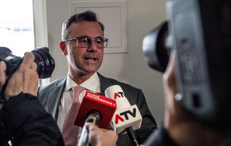 epa05275249 Right-wing Austrian Freedom Party (FPOe) presidential candidate Norbert Hofer answers media question at his party headquarter during Austrian presidential elections in Vienna, Austria, 24 April 2016. Over six million Austrians are casting their votes to elect the next Austrian president. If no candidate achieves the outright majority, more than 50 percent of valid votes, the run-off will take place on 22 May 2016.  EPA/FILIP SINGER
