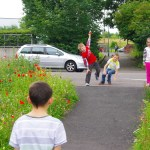 Kids play on the 'Brothers Path' a vacant site transformed with wild flowers: picture Depot Arts