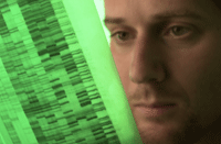 Researcher looking at a DNA sequence