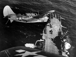 SB2C-4 banks over USS Hornet in the China Sea in January 1945 . Navy photo.