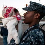 CORONADO, Calif. (Nov. 30, 2010) Boatswain's Mate Seaman Issac Doyle says goodbye to his daughter as he prepares to board Nimitz-class carrier USS Carl Vinson (CVN 70) before the ship departs Naval Air Station North Island for a three-week composite training unit exercise (CTX) and Western Pacific deployment. (U.S. Navy photo by Mass Communication Specialist 2nd Class Byron C. Linder/Released)