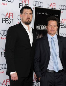 "Former Special Operator 1st Class (SEAL) Marcus Luttrell, left, and Mark Wahlberg pose at the  the premiere for ""Lone Survivor"" on Tuesday in Hollywood, Calif. (Getty Images photo by Valerie Macon)"