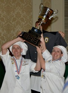 Oak Hill Culinary Specialist 1st Class Eric Moore, Culinary Specialist 1st Class Cynthia Cruz and Culinary Specialist 2nd Class Cameron Tirabassi, 2014's Best of the Mess winners, show off their trophy.  (Navy photo by MC2 Molly Greendeer)