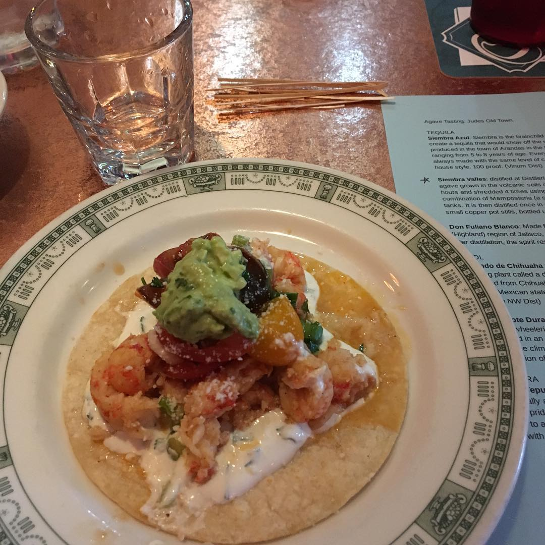 Crawfish taco and sotol at Jude's Old Town.