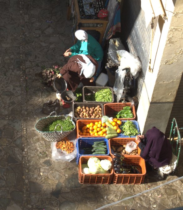 Women selling fruit and vegetables in a square in the medina of Tangiers.