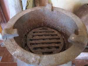 An old cooking brazier - hot stones placed under, pan on top.