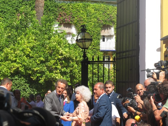 The Duquesa with her third husband on their wedding day, outside her palace in Seville.