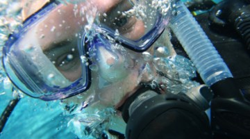 Should divers wear a snorkel while scuba diving?