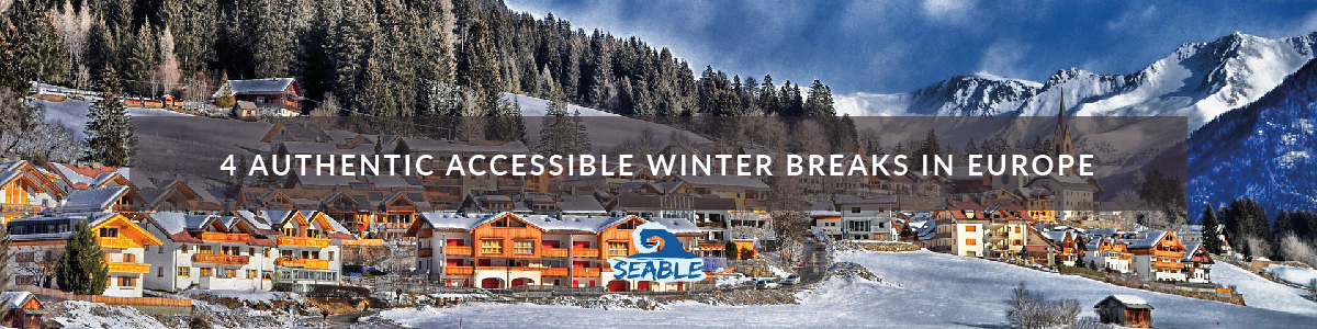a snowy mountain with the caption 4 authentic accessible winter breaks in europe