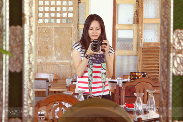 I love the details of this mirror, the capiz shell windows behind me and the wooden furniture around the house.