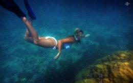 Renee Blundon at a Coral Rock off Cost of Mbudya Island 1680 x 1050