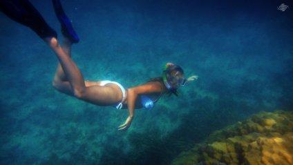 Renee Blundon at a Coral Rock off Cost of Mbudya Island 1920 x 1080