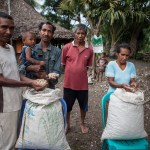 Members of the seed harvesting group display their peanut harvest in Tequinomata, Sub-District Laga, rural Timor-Leste.