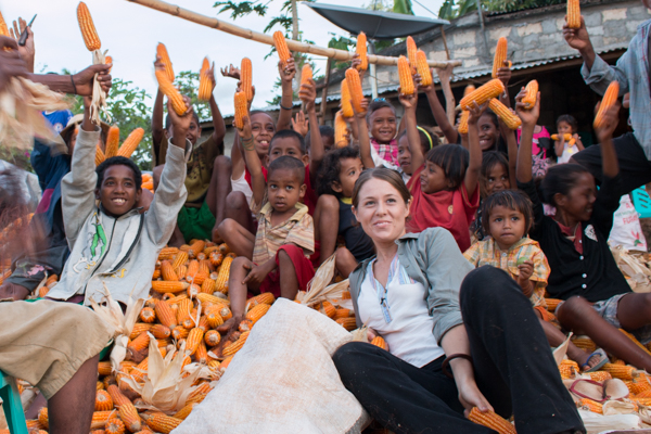 Host Leesa sits on a mountain of corn with family members of the Raimean commercial seed producer group in Baucau district © Jessy Betty/Seeds of Life