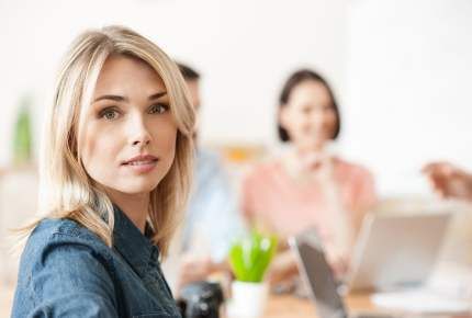 Attractive lady is working with her team