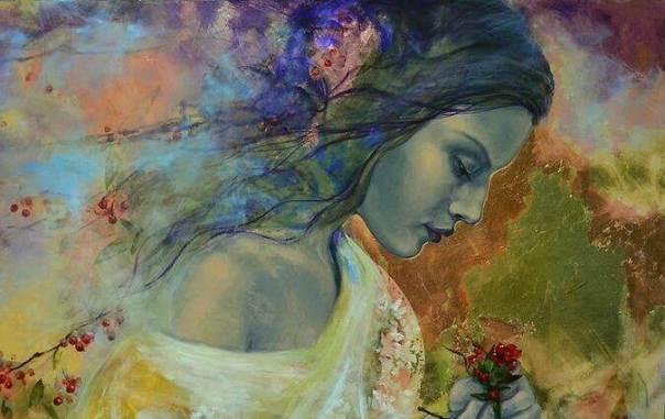 Mujer-triste-mirando-unas-flores-que-tiene-en-sus-manos