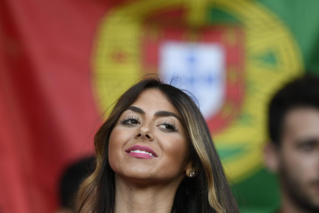 A Portugal supporter cheers prior to the Euro 2016 group F football match between Portugal and Austria at the Parc des Princes in Paris on June 18, 2016. / AFP PHOTO / MARTIN BUREAU